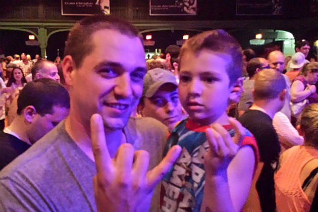 Kid and his dad at the rock show