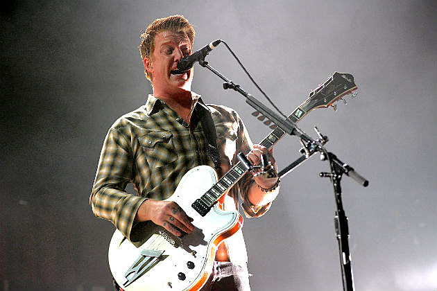 Josh Homme of QOTSA on stage