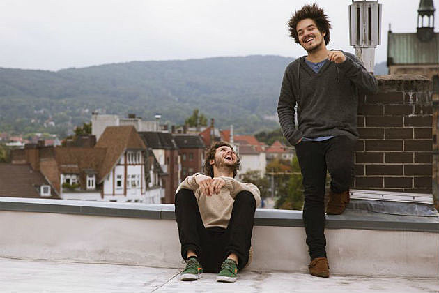 Milky Chance band members on a roof