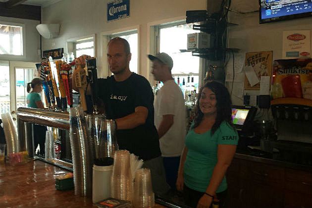 Rob pouring a beer at The Porthole